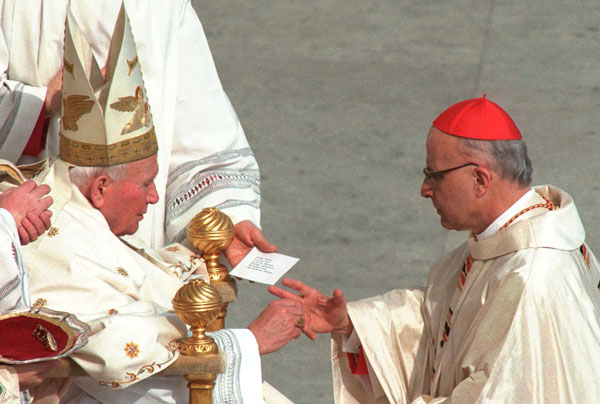 Pope John Paul II presents cardinal Francis Eugene George, archbishop of Chicago, IL, with a golden ring during the &#34;Mass of the Rings&#34; held in St. Peter&#39;s Square at the Vatican, Sunday, February 22, 1998, and during which the Pope bestowed golden rings on those he called newest &#34;princes&#34; of the church. The Pontiff elevated 22 prelates to cardinal Saturday during a public Concistory.  <span class=meta>(&#40;AP Photo&#47;Massimo Sambucetti&#41;)</span>